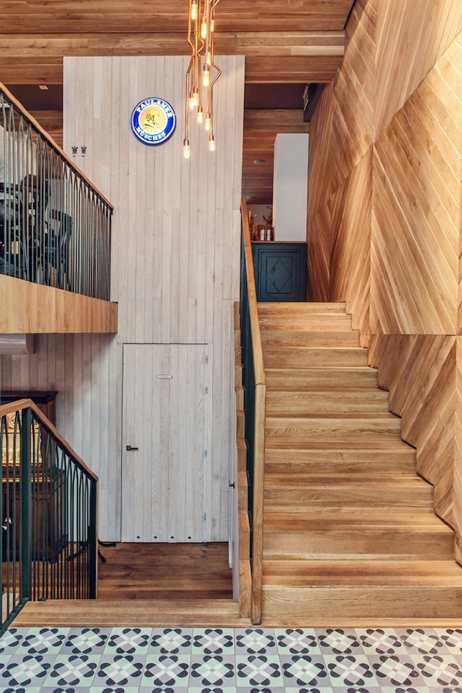 Althaus Restaurant, entry, stair, timber wall panelling, copper chandelier