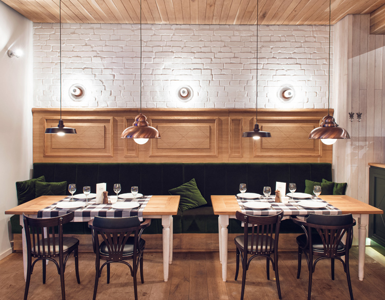 Althaus Restaurant, dining room, painted brick wall, green velvet upholstery, brass pendant lighting