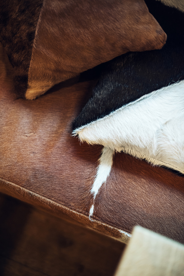 cowhide upholstery, details, cushions
