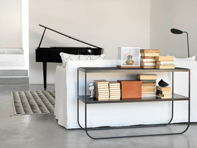 Asplund LUC top, black piano, white sofa, concrete floor, product styling