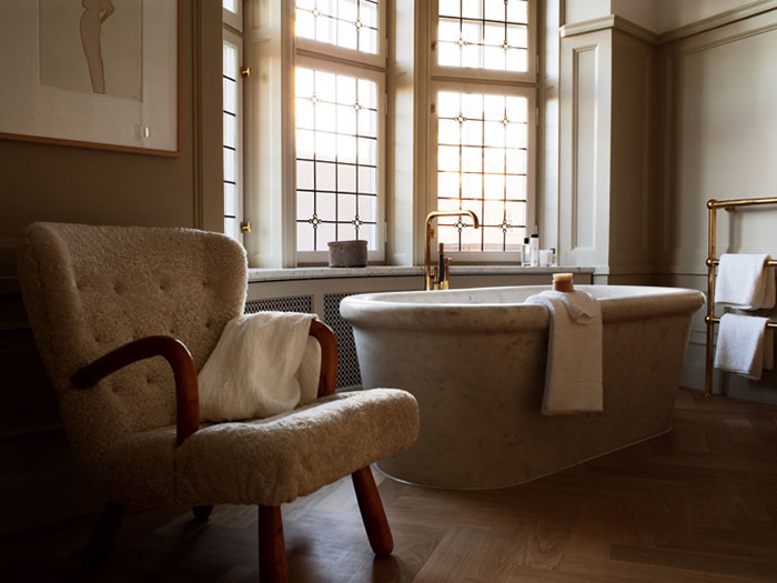 ett hem hotel bathroom with bath carved from single slab of marble