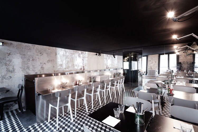 PNY upstairs dining room, black ceiling, uplighting, cement floor tiles