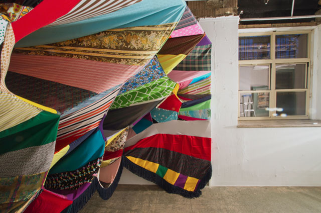 Prismatic Vortex by Amanda Browder, recycled textile installation, patchwork pattern and colour