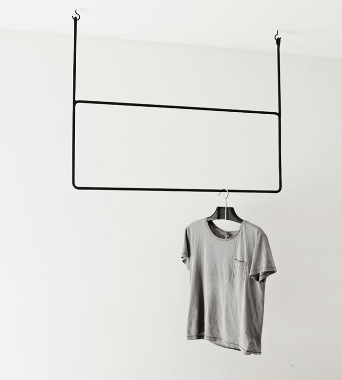 Suspended clothing rails by Annaleena Leino | Yellowtrace.
