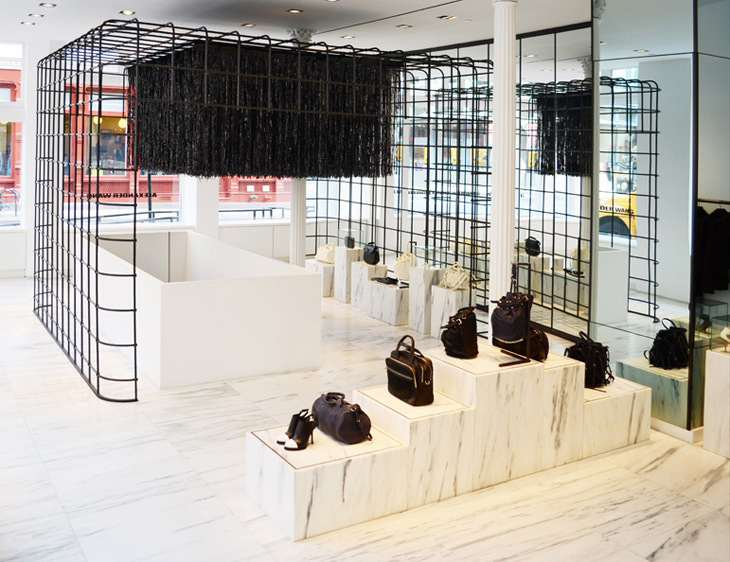 CFDA winner Alexander Wang celebrates his new Soho New York flagship store with American Express. Q+A chats it up with the designer at the exclusive AMEX card member-only shopping event.
