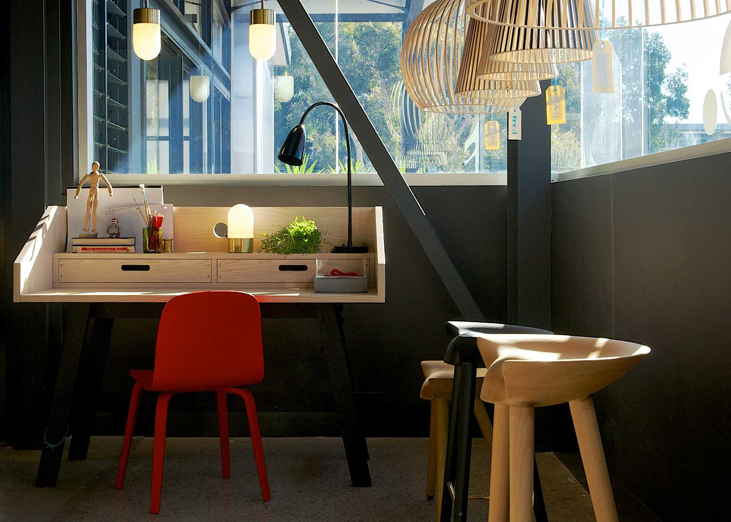 Fred International Sydney Showroom by Yellowtrace, MUN15 Desk by Slowwood, Muuto Visu chair in red., Vox brass table lamp & Arkipelag black table lamp from Ruben Lighting, Vox ceiling light, Secto Design lights. By Lassen ML 42 timber stools.