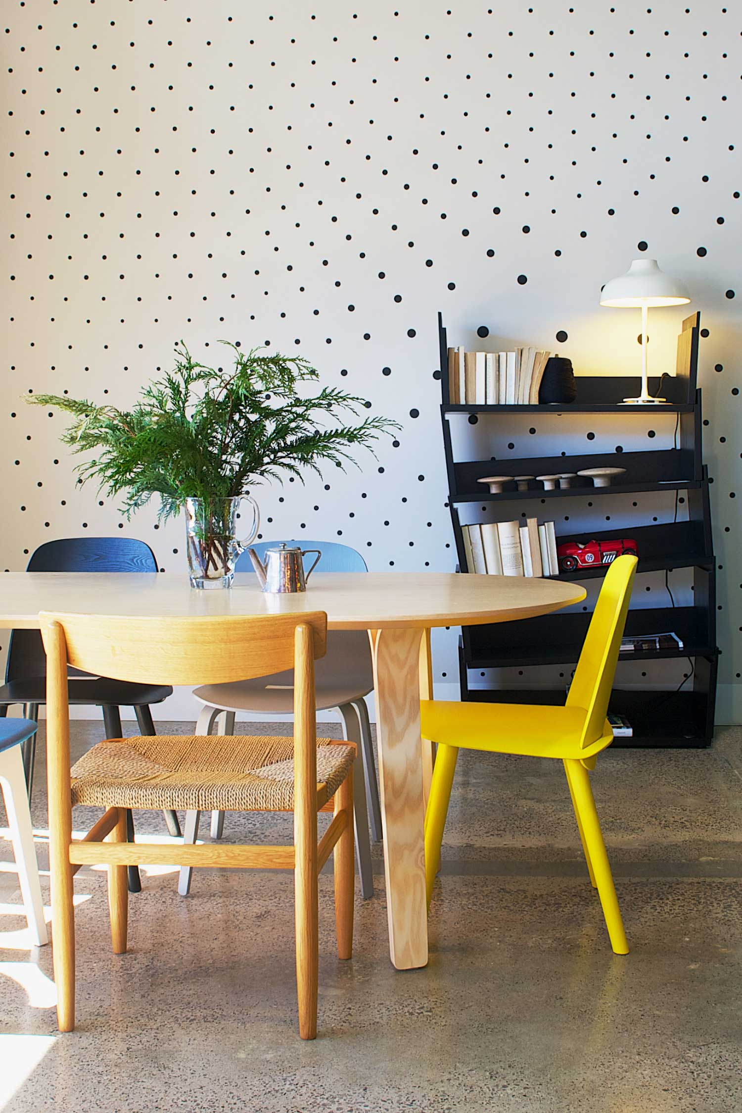 Fred International Sydney Showroom by Yellowtrace. Swedese Divido table,  Karl Anderson & Söner Øresund chair, Muuuto Nerd Chair, Muuto Visu chair. Swedese Black Ivy bookshelf. White Bolero light by Ruben Lighting. Custom black dot wall decal by War Design. Photo by Nick Hughes.