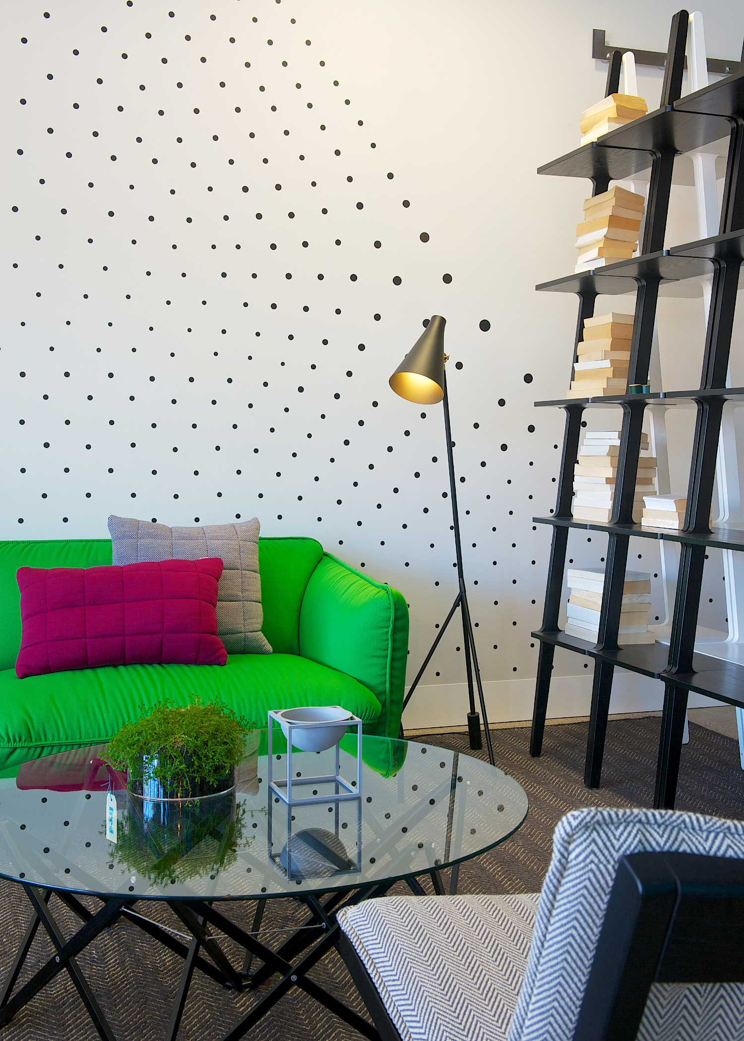 Fred International Sydney Showroom by Yellowtrace. Swedese green Continental Sofa, Muuto Cushions, Karl Anderson & Söner Itomaki coffee table, grey Bowl By Lassen, Ruben Lighting Hunter floor lamp, Swedese Libri bookshelves in black and white, Swedese Cruiser Armchair, Armadillo & Co Herringbone Weave rug, Custom black dot wall decal by War Design.