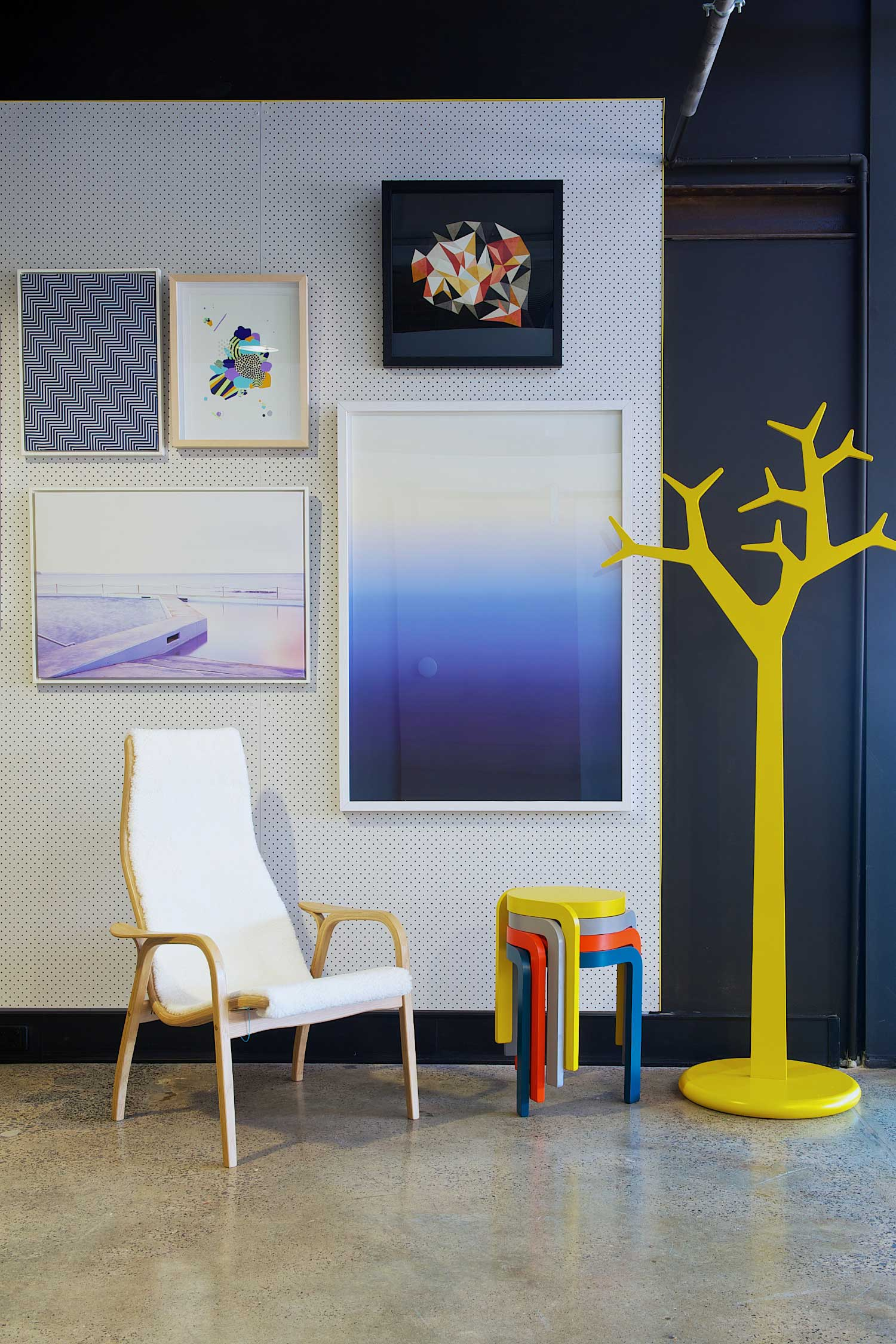 Fred International Sydney Showroom by Yellowtrace, Swedese Lamino Chair in oak frame and white sheepskin, Swedese Spin stools, Swedese Tree in yellow, artwork by I Need Nice Things.