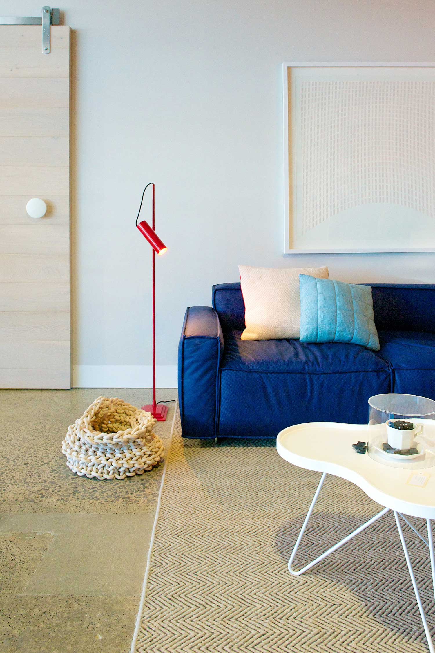 Fred International Sydney Showroom by Yellowtrace. Boxplay sofa by Claesson Koivisto Rune, Muuto Cushions, Red Nomad floor lamp from Ruben Lighting, Swedese White Flower Mono coffee table, Armadillo & Co Herringbone Weave rug, Knitted basket by Little Dandelion, artwork by I Need Nice Things.