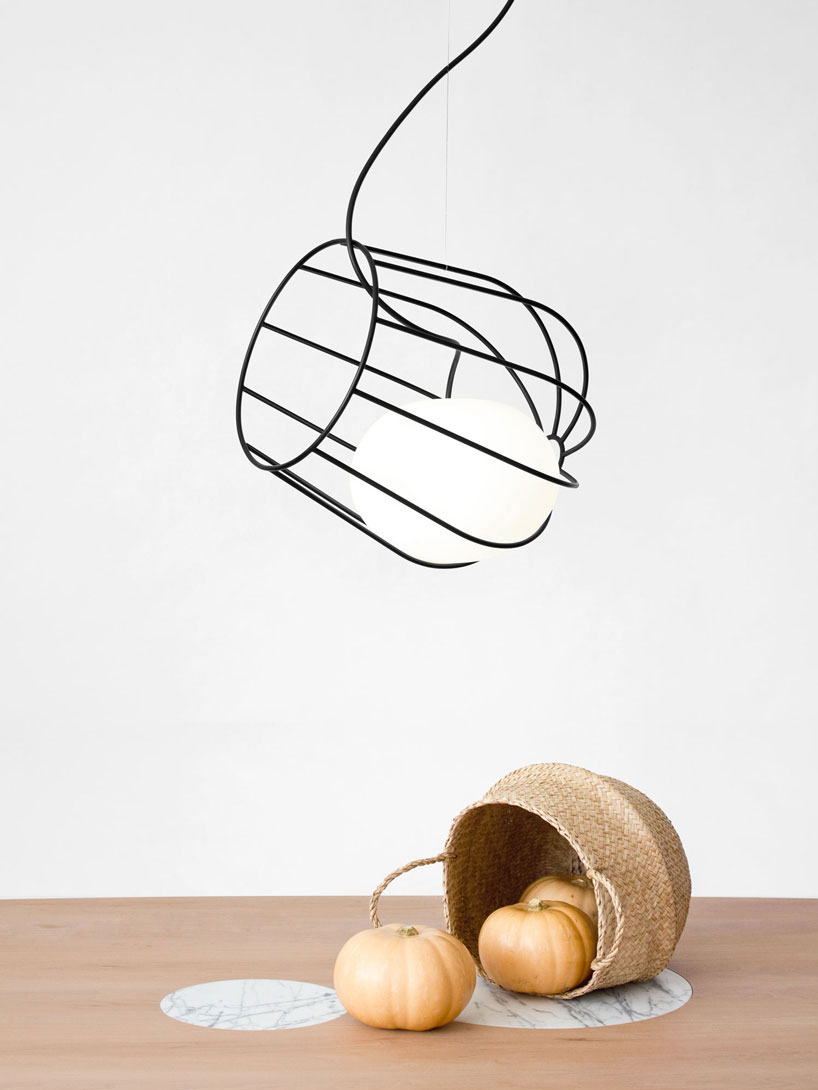 Floating Light Suspended Inside a Painted Metal Basket by Martin Azua.