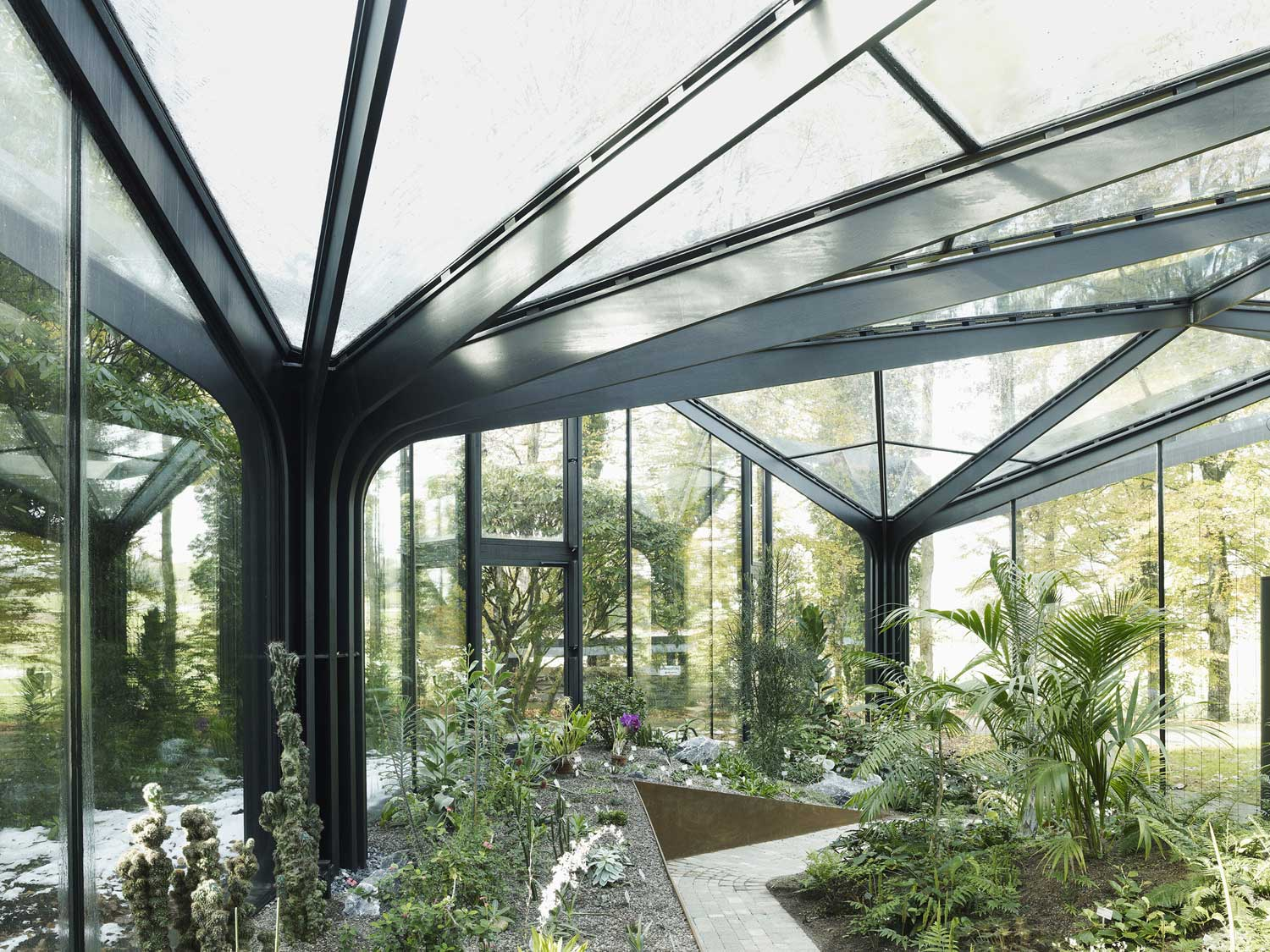 Greenhouse at Grüningen Botanical Garden by Buehrer Wuest Architekten | Yellowtrace
