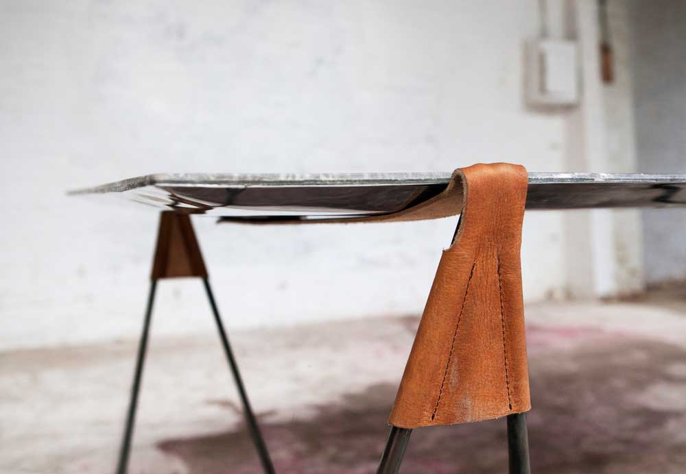In Vain Marble Trestle Table by Ben Storms | Yellowtrace