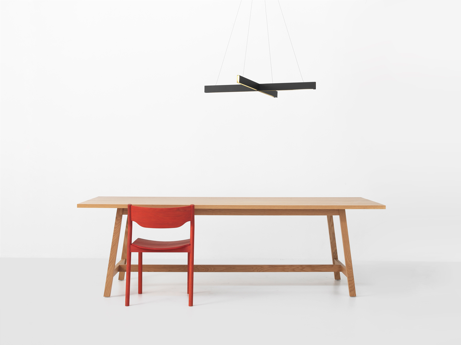 Lovely Cross Pendant, Hawk Table And Tangerine Chair | Yellowtrace