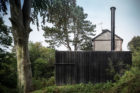 A Black House in the Forest by Marchi Architectes | Yellowtrace
