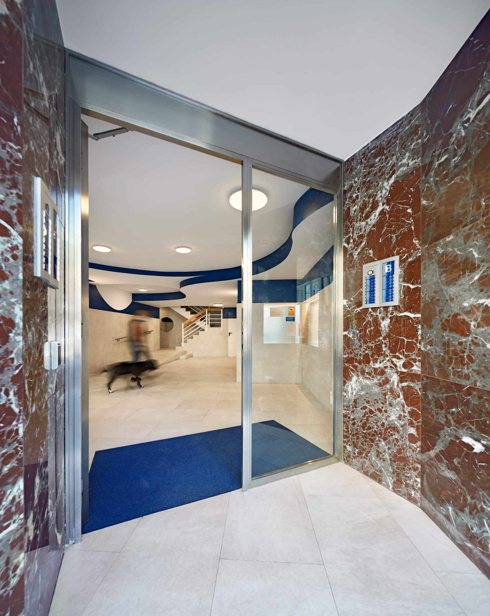 Pintor Pahissa Residential Entrance Lobby Refurbishment by Miel Arquitectos.