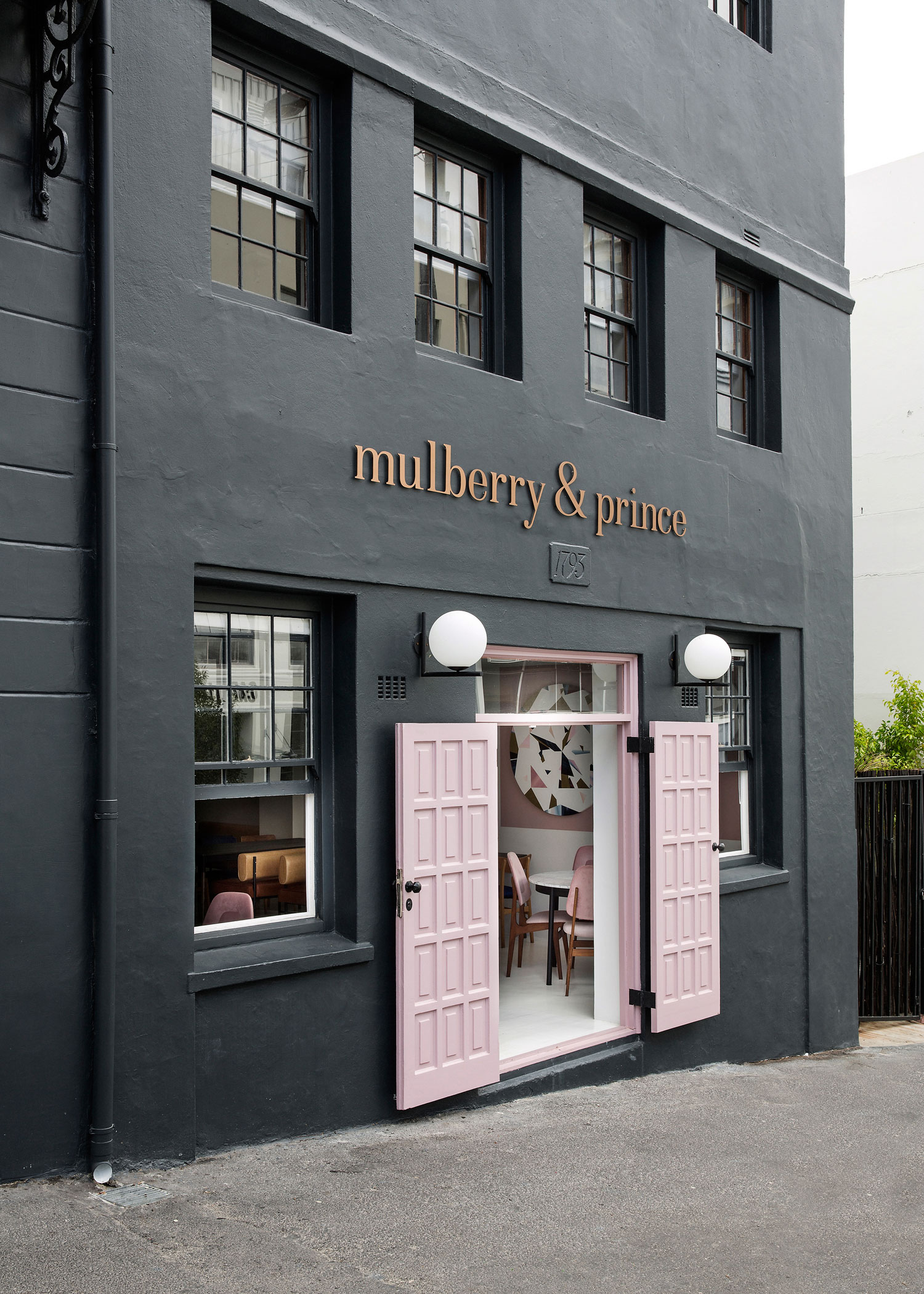 Mulberry prince cape town by atelier interiors for Retail shop exterior design