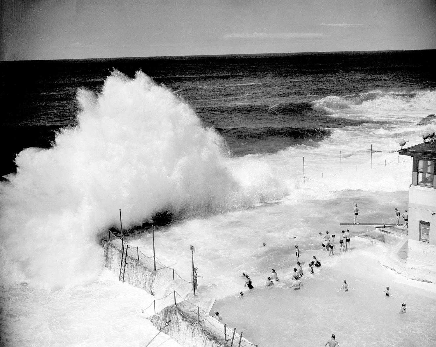 Waves Breaking into the pool at Bondi Beach in 1945. Photographer Unknown, courtesy of National Archives of Australia | Yellowtrace