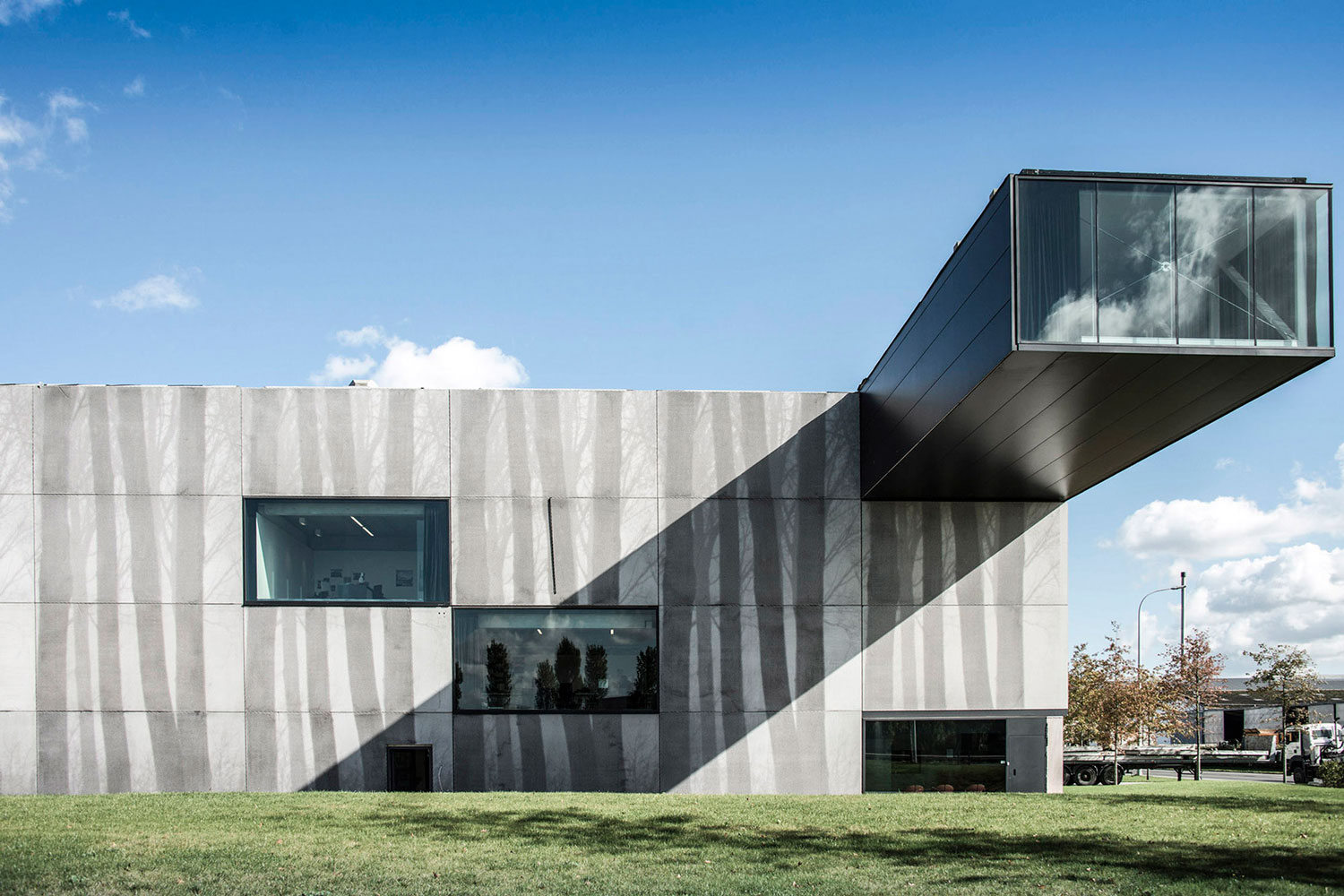 Enjoy Concrete HQ by Govaert & Vanhoutte Architects | Yellowtrace