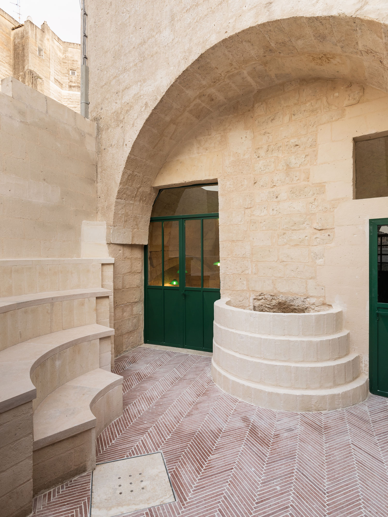 Enoteca dai Tosi: Wine Bar Carved Into a Mountain in Matera, Italy, Designed by Architecten De Vylder Vinck Taillieu   Yellowtrace