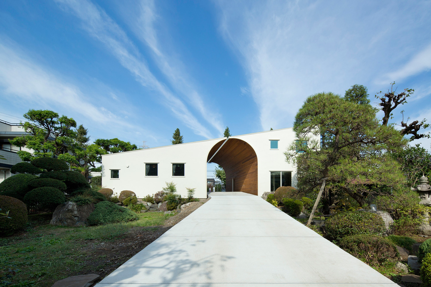 Arch Wall House by Naf Architect & Design | Yellowtrace