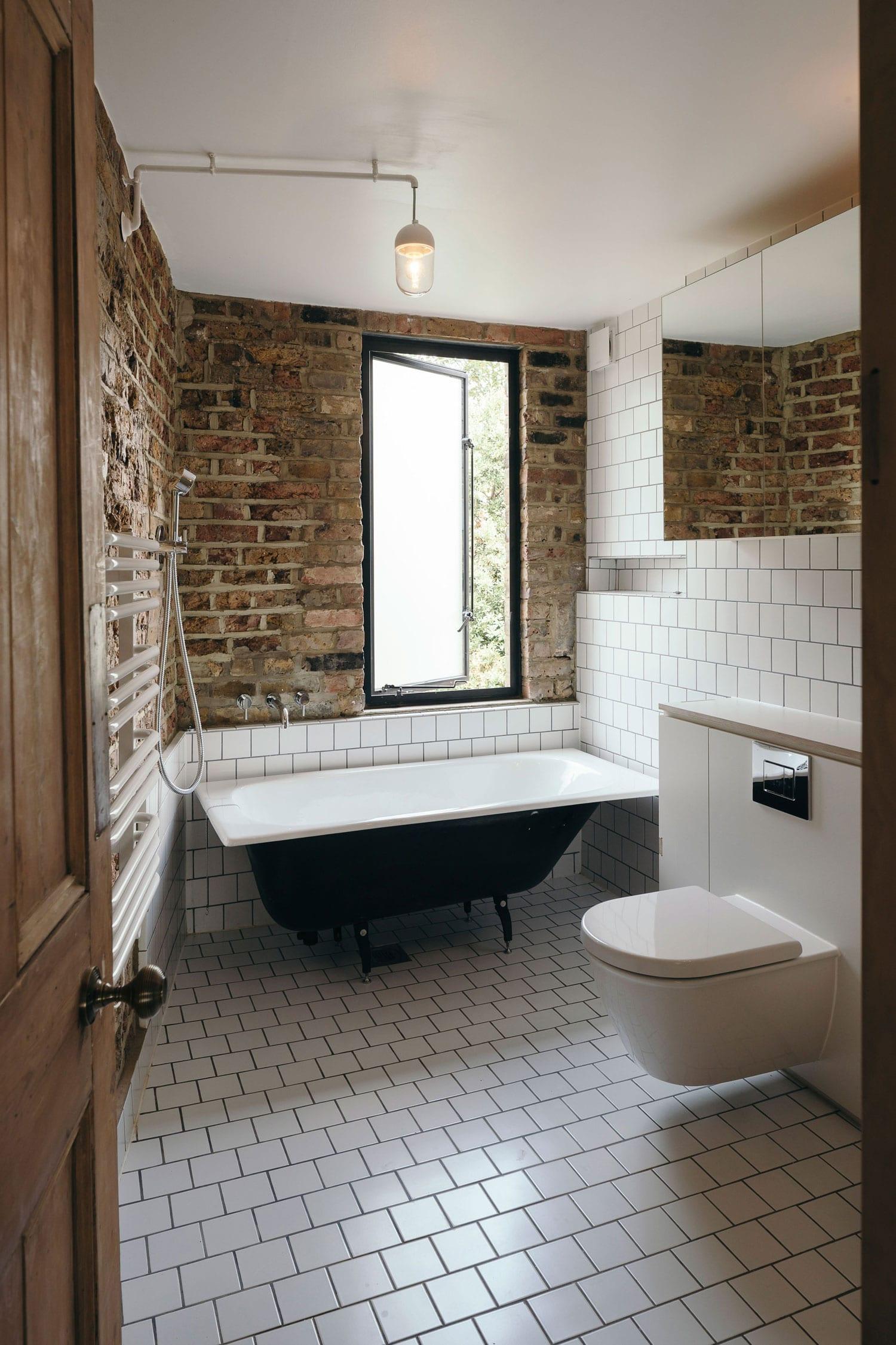 tsuruta architects radically refurbish a former squat house london.