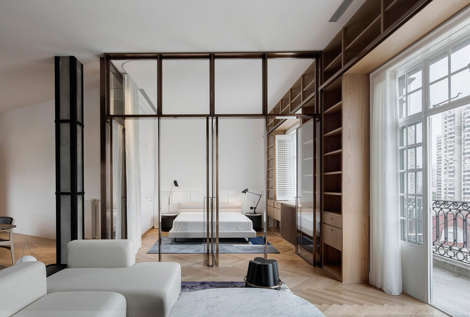 Shanghai apartment lined with floor to ceiling bookshelves by atelier tao c
