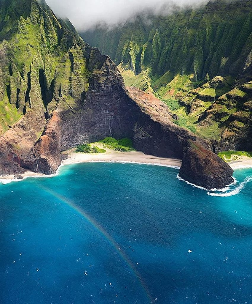 Rainbow over Nā Pali Coast State Park, Hawaii by March Romano | Yellowtrace