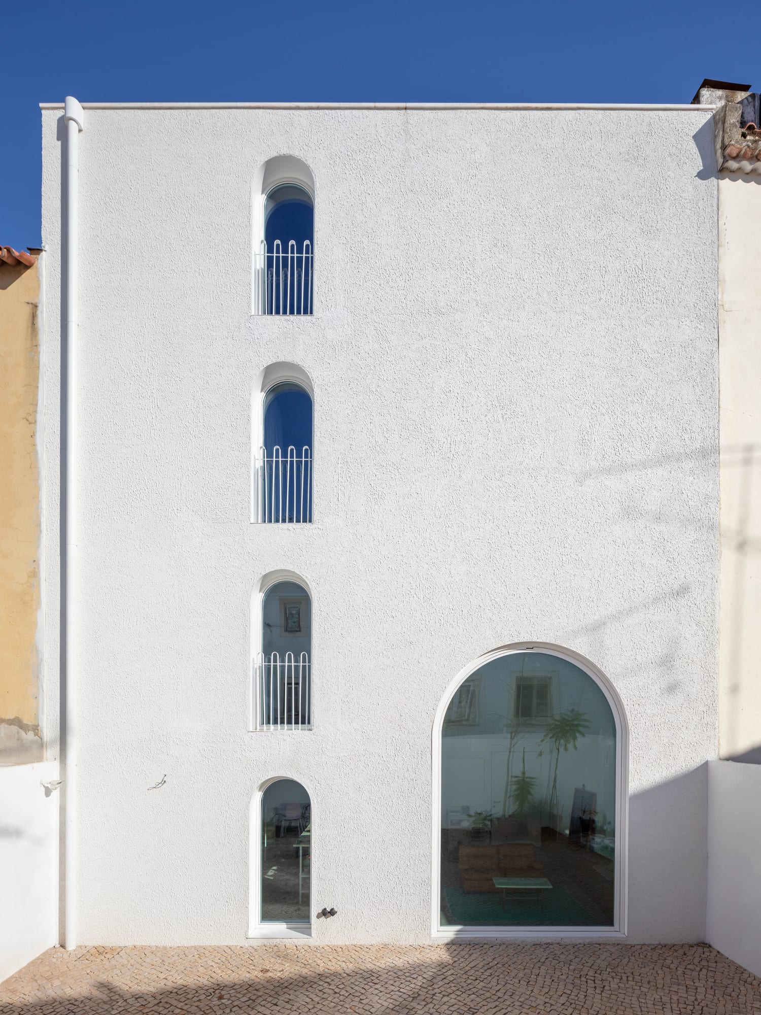 Dodged House in Lisbon, Portugal by Leopold Banchini + Daniel Zamarbide.
