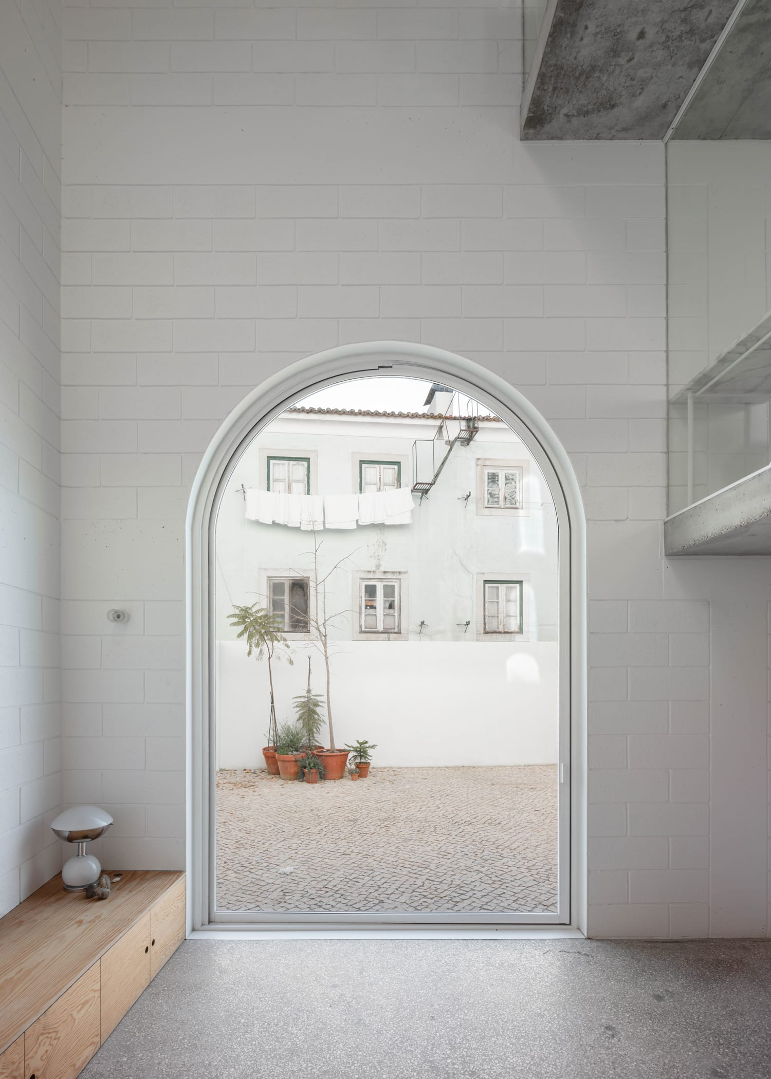 Dodged House in Lisbon, Portugal by Leopold Banchini + Daniel Zamarbide | Yellowtrace